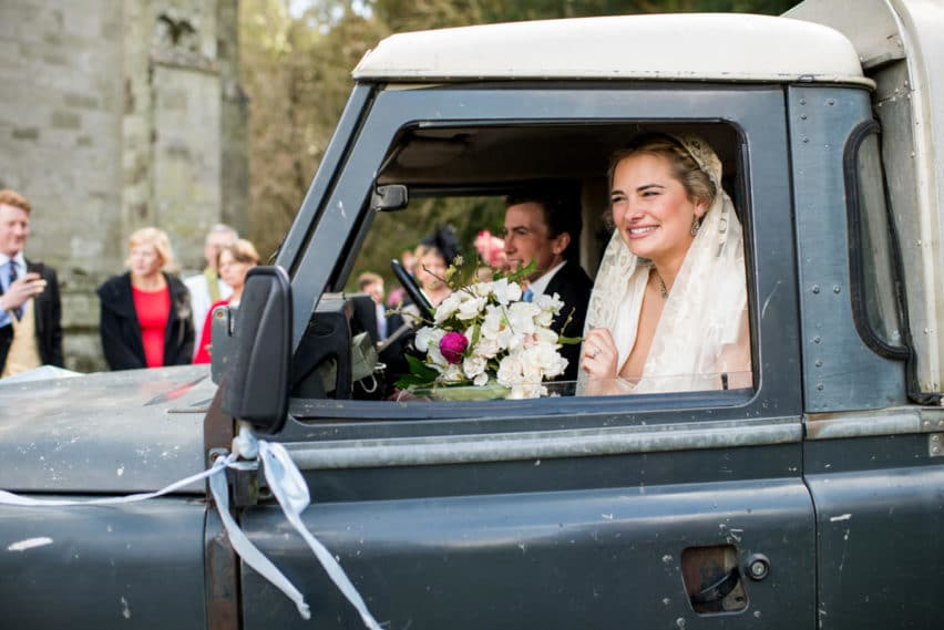 bride and groom in jeep