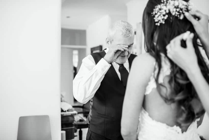 emotional moment between bride and father