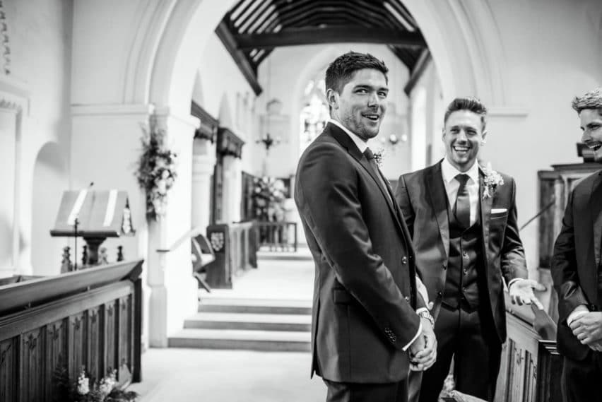 groom and best men waiting in church
