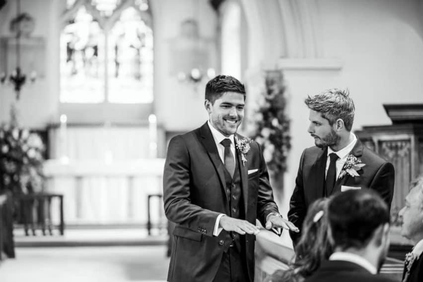 groom looking nervous in church