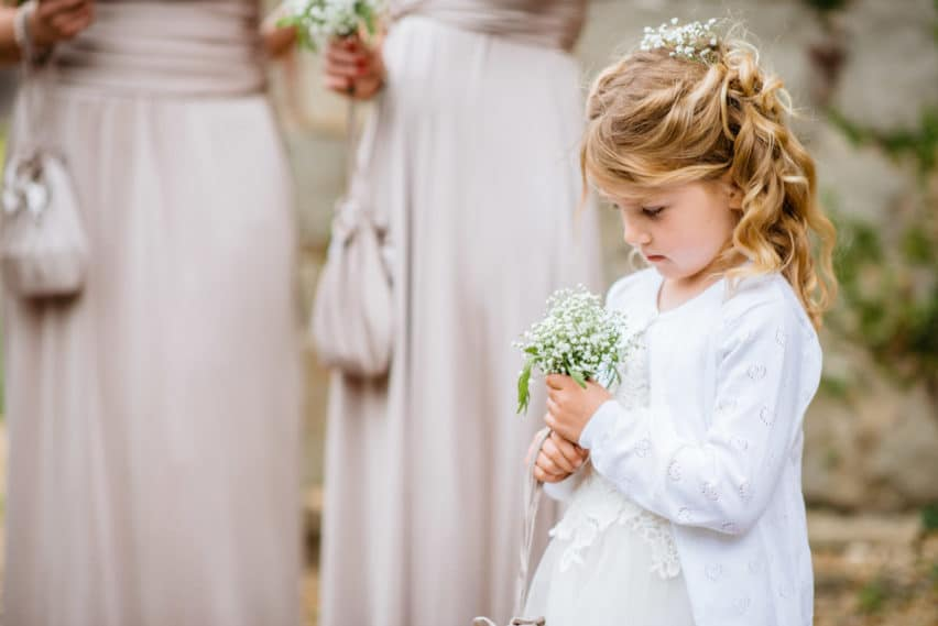 flower girl looking at her flowers