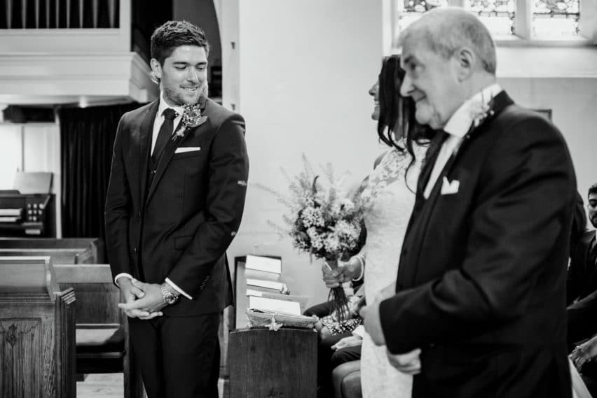 groom sees his bride in the church for the first time