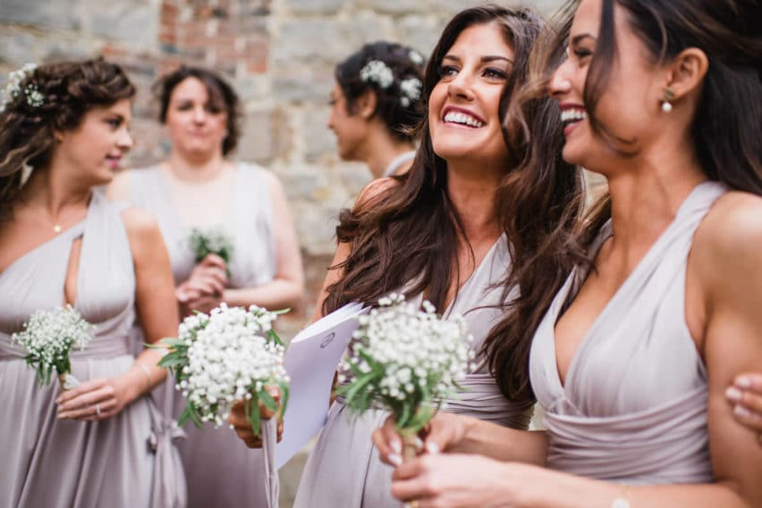 bridesmaids smiling outside church