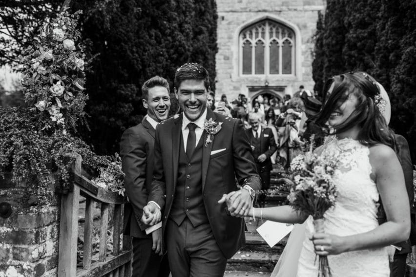bride and groom leaving church grounds