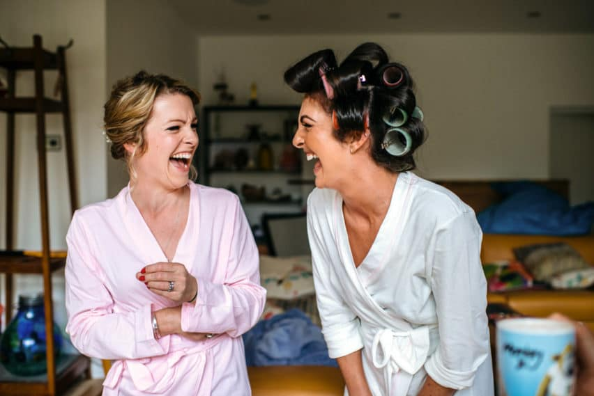 bride laughing hard with sister