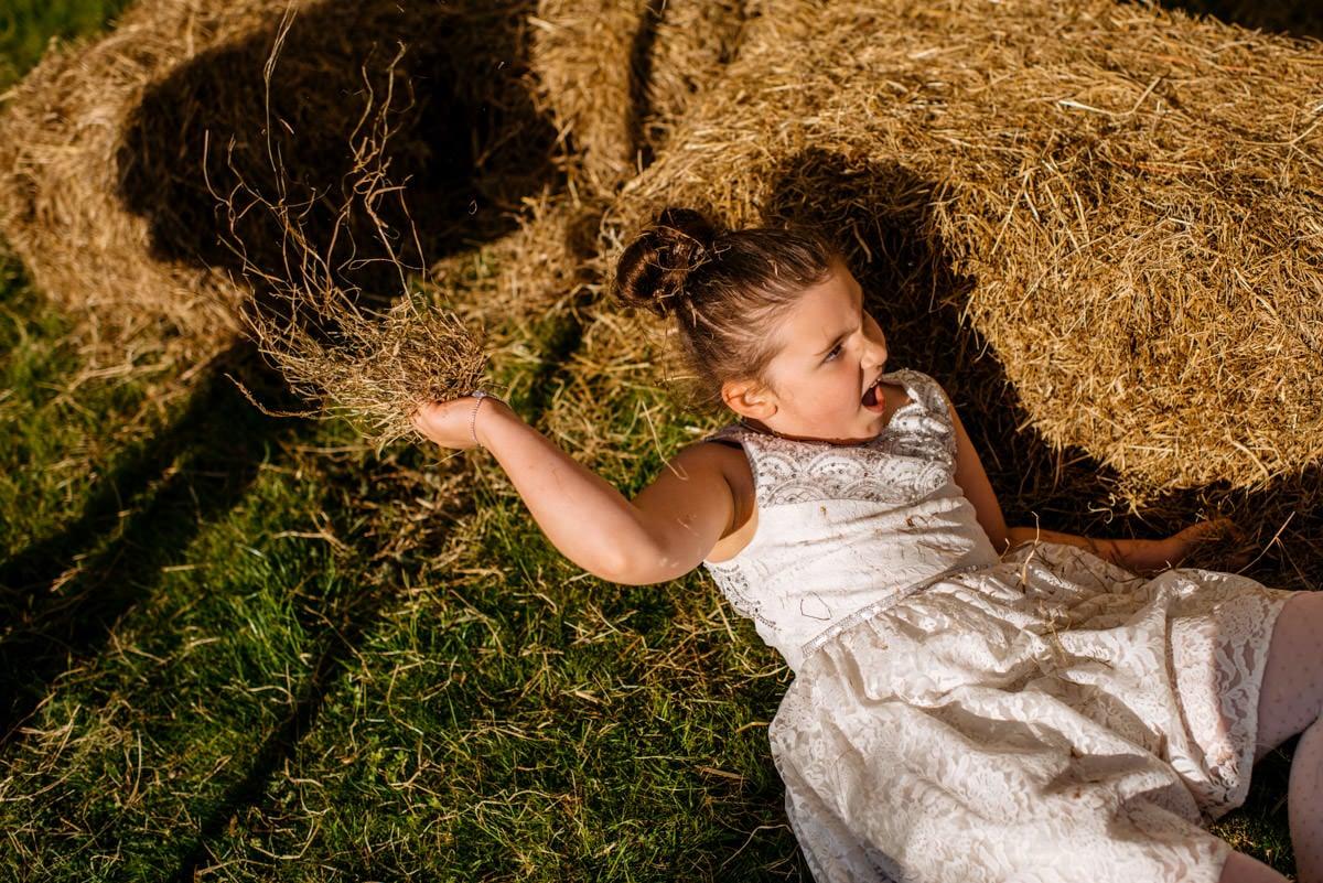 kid throwing hay