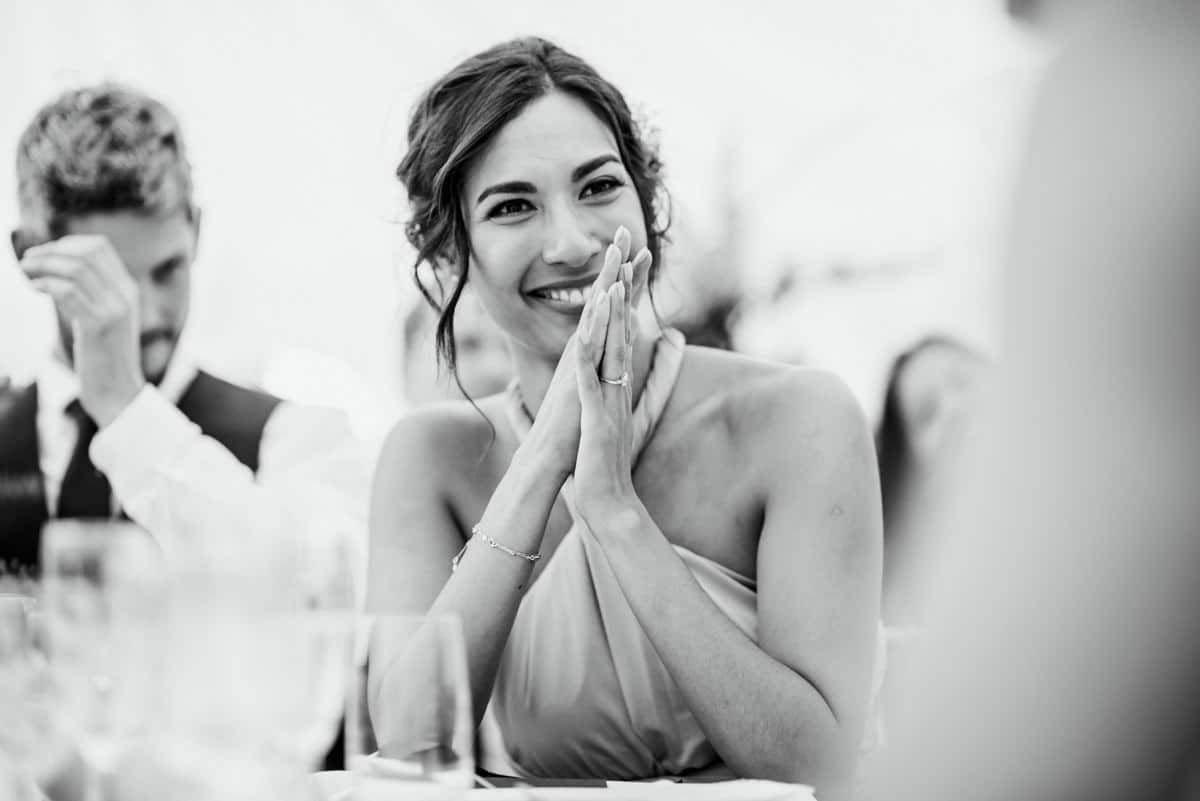 bridesmaid during speeches looking happy