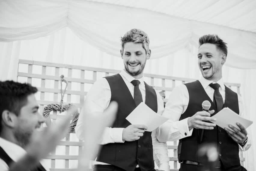 two best men giving their speech at a wedding