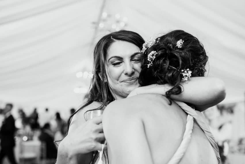 bride giving a loving hug