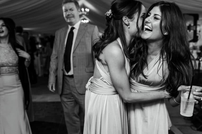 laughter on dancefloor of wedding