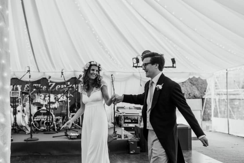 bride and groom make their entrance into Marquee