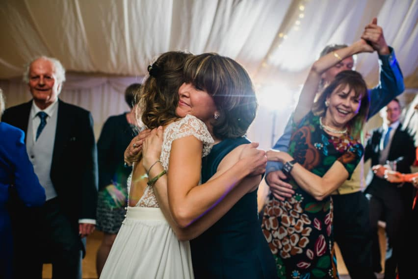 bride hugging mother of groom