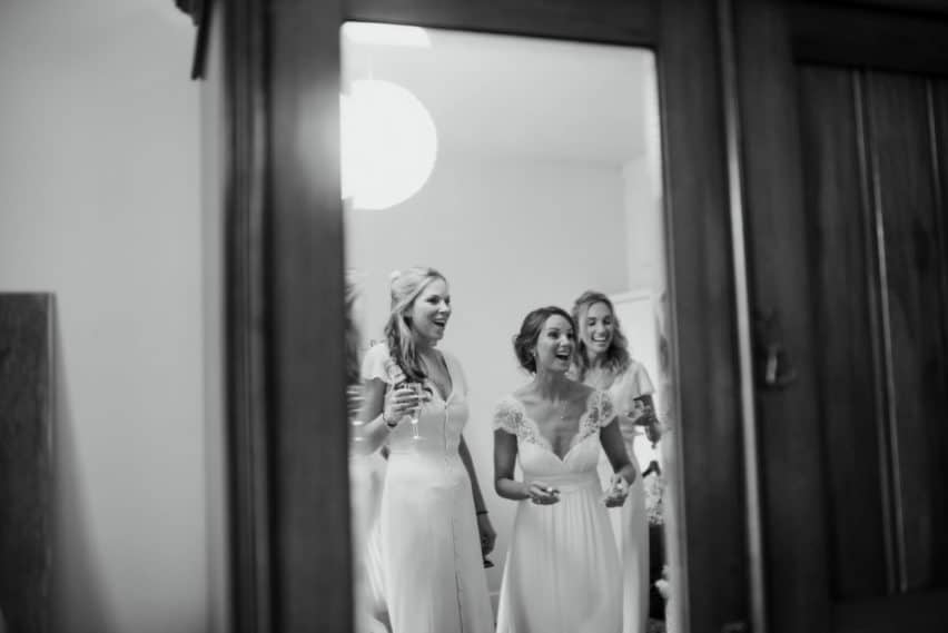 bride and bridesmaids in mirror