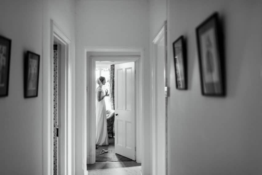 bride framed by door