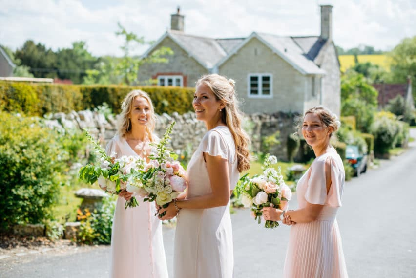bridesmaids in pastel pink dresses