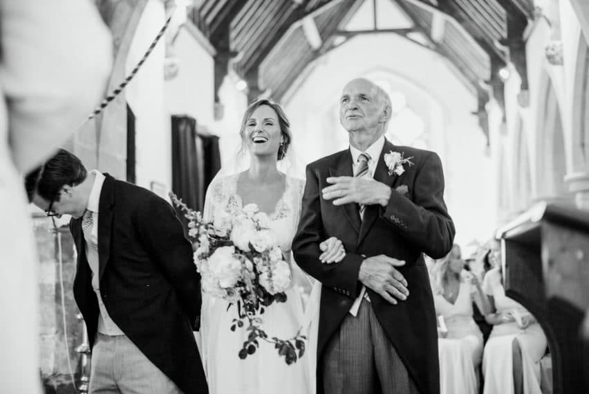 bride, groom and father in church