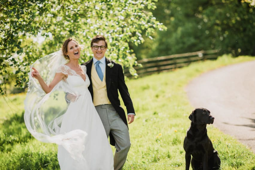bride and groom portrait with their dog