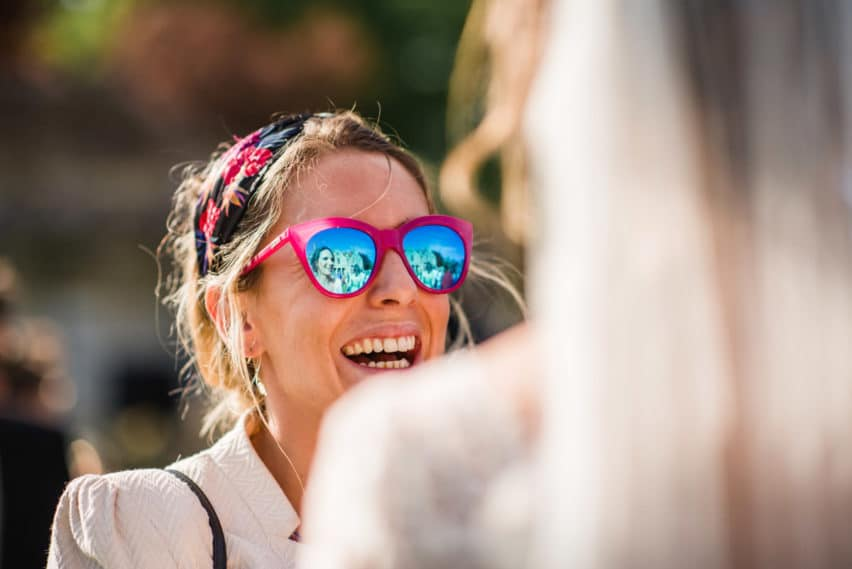 wedding guest wearing mirrored glasses