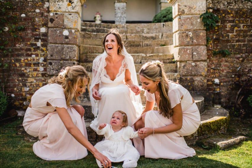 flower girl crying in wedding group shot
