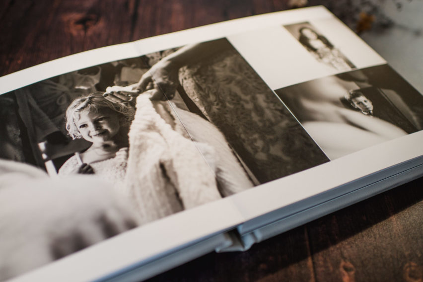 wedding album with picture of flower girl on page