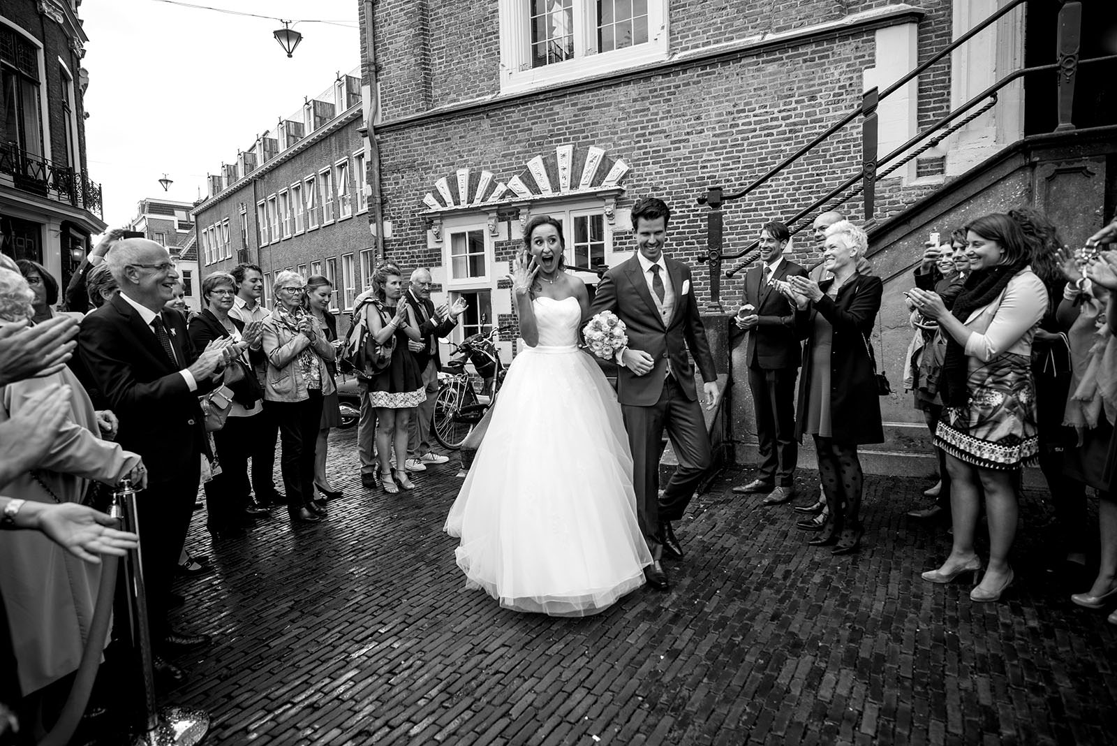 Haarlem wedding couple holding up ring hand after ceremony