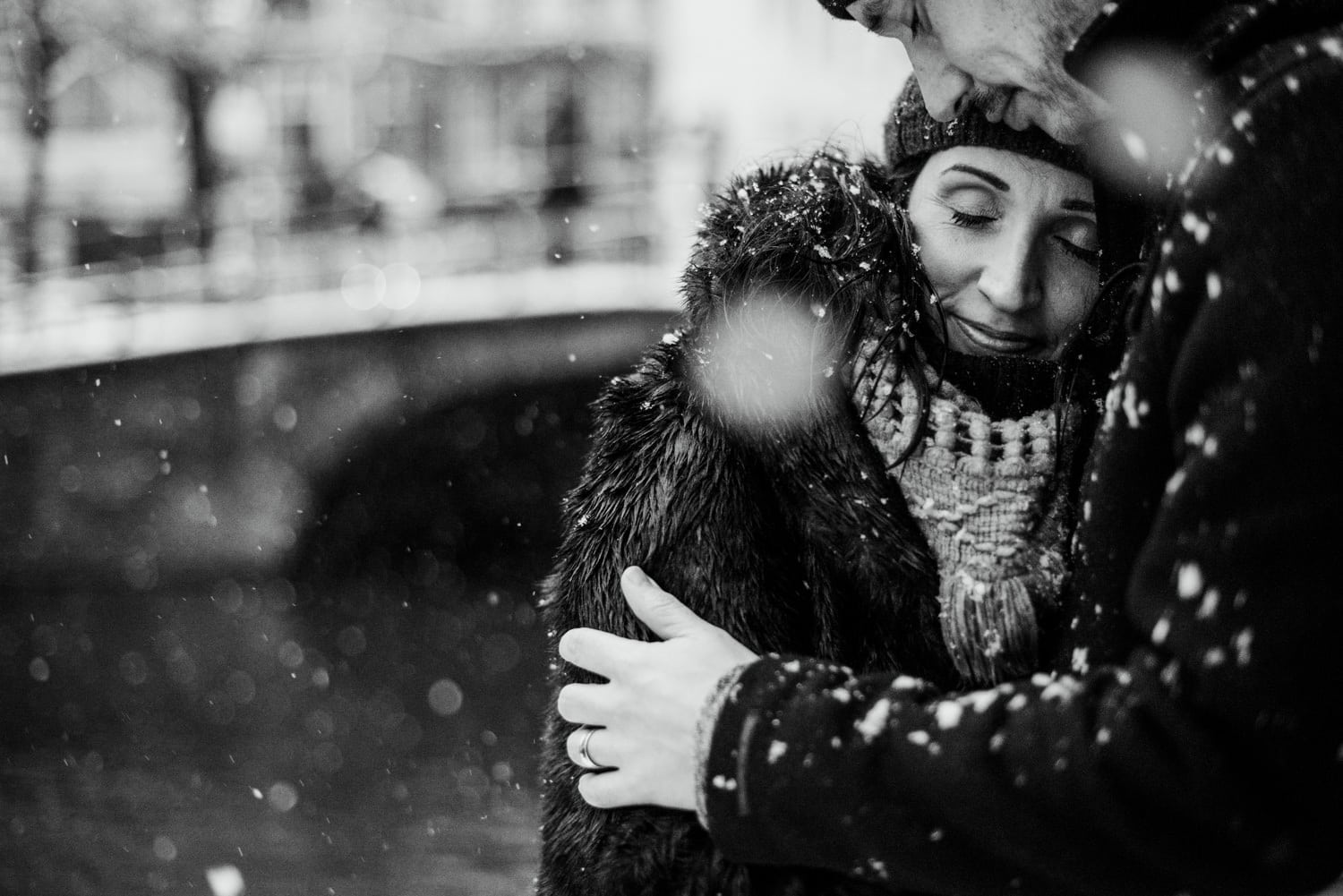 couple embracing in snow