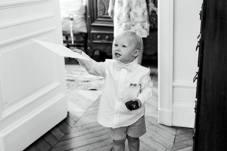 pageboy handing over gift to groom