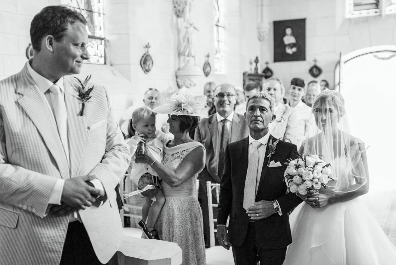 bride walking down the aisle at Chateau de Lacoste France