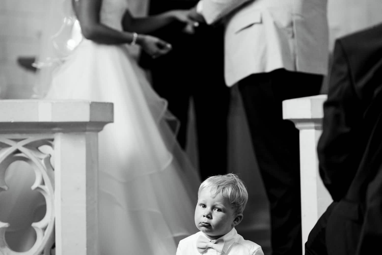 kid sitting on step in church
