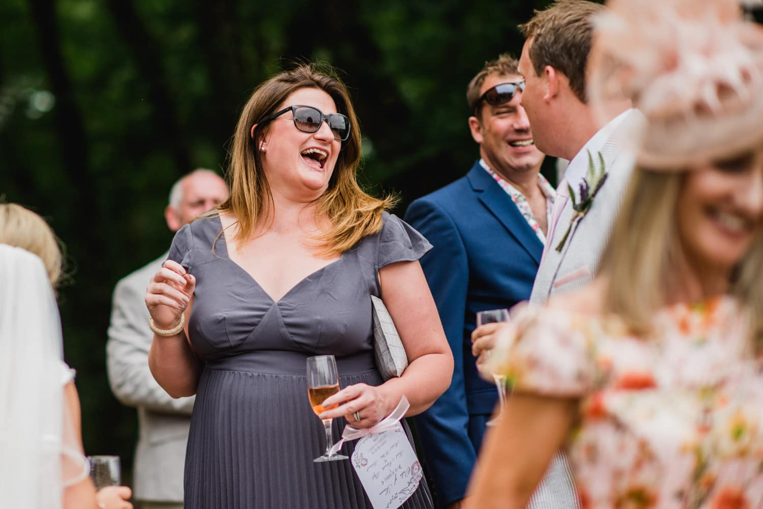 wedding reception guests laughing