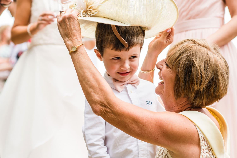 little boy trying on wedding hat