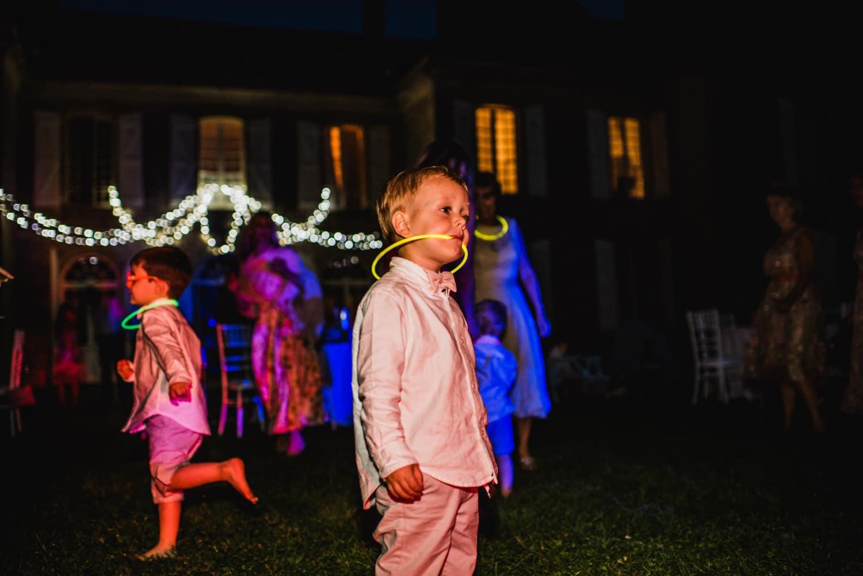 kids with glow sticks at wedding