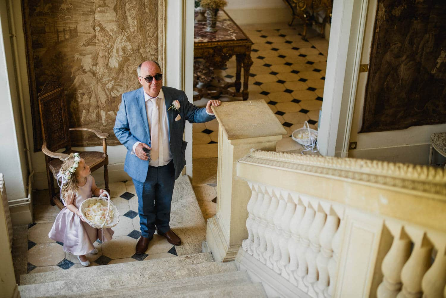 father of the bride waiting at the bottom of the stairs at Chateau la Durantie