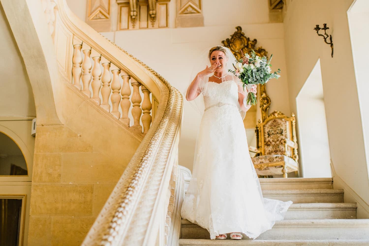 bride walking down the stairs at Chateau la Durantie