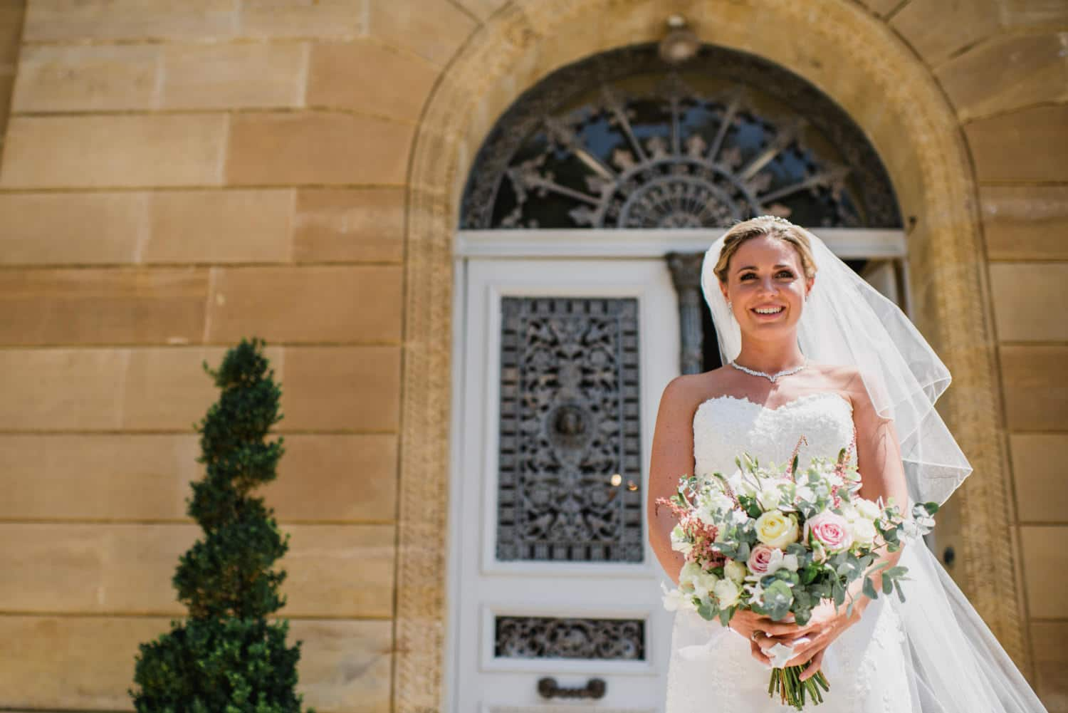 Wedding Photography in France bride outside chateau la Durantie
