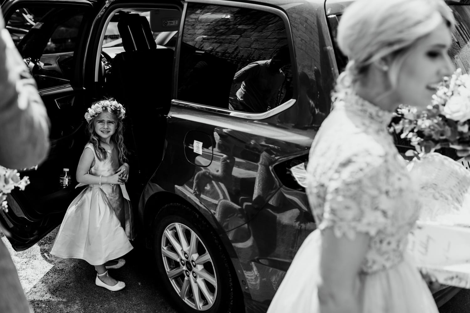 flower girl getting into car