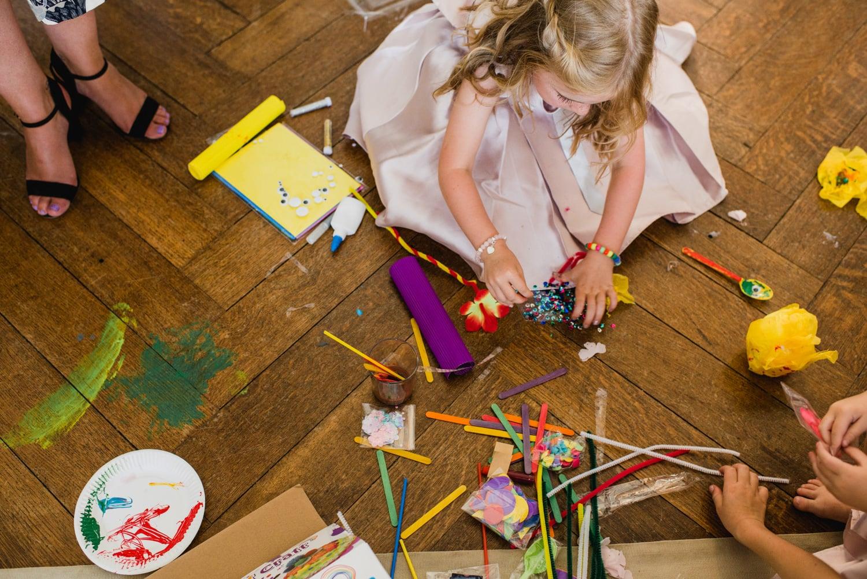 kids colouring on floor