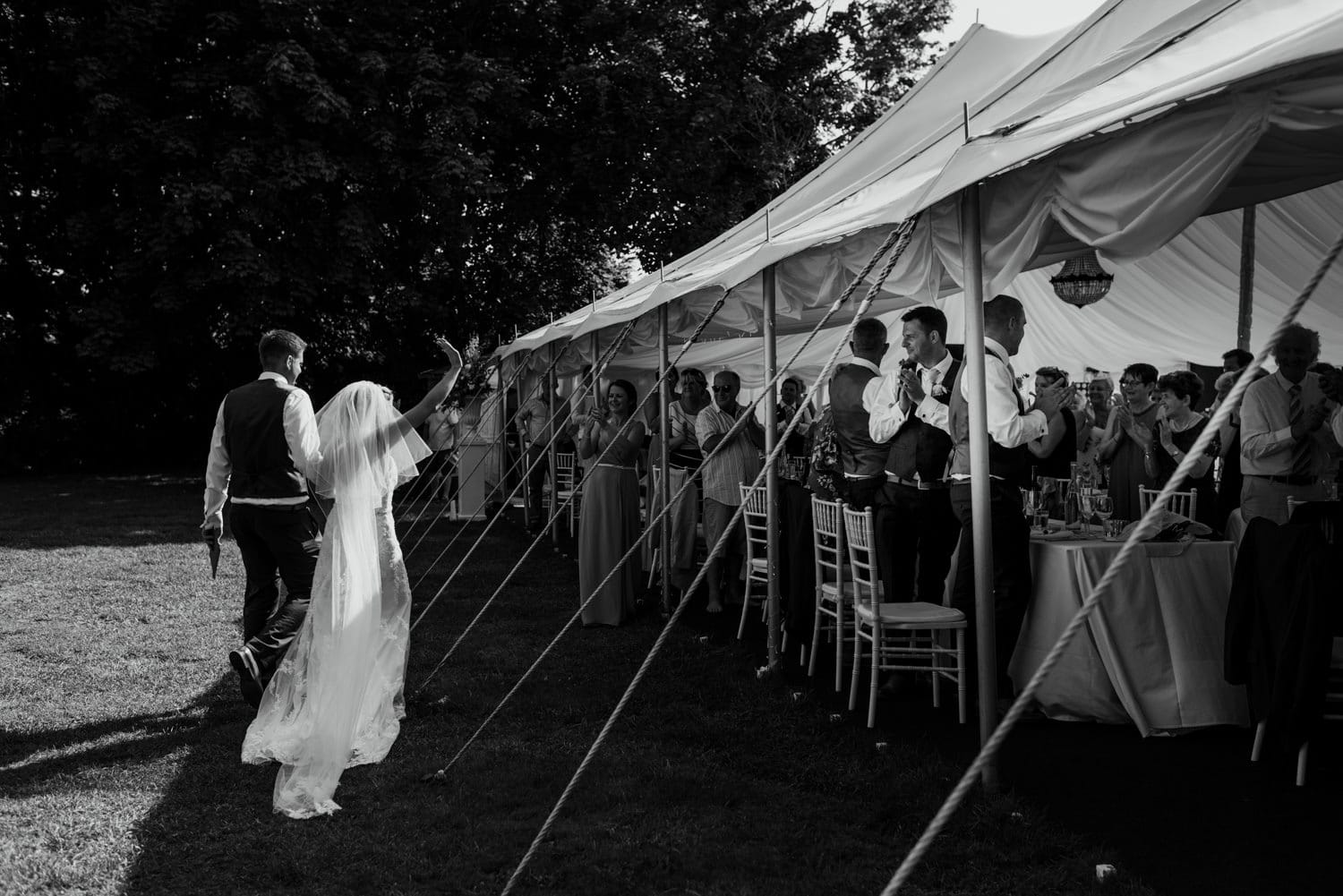 bride and groom walking to their table