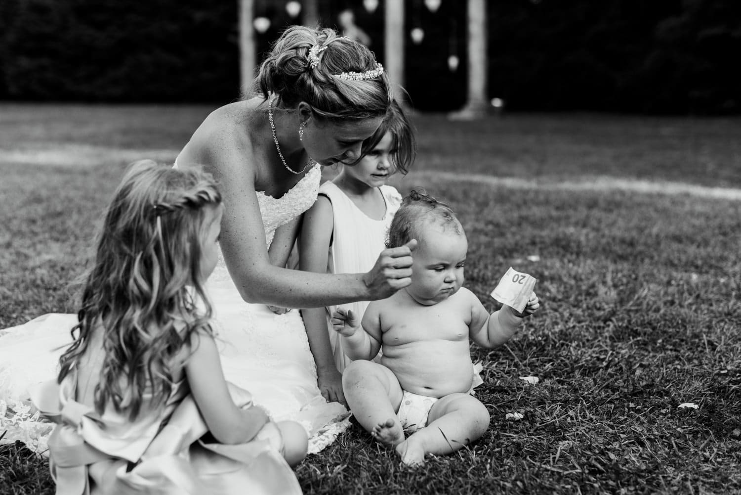 baby holding money at wedding