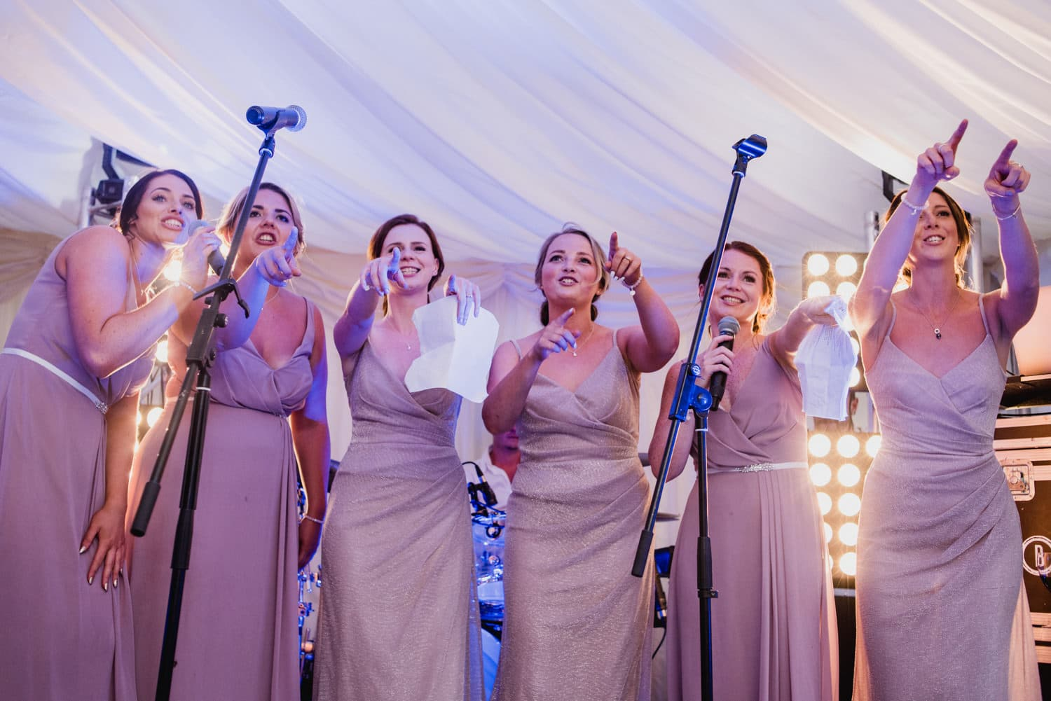 bridesmaids rapping at wedding