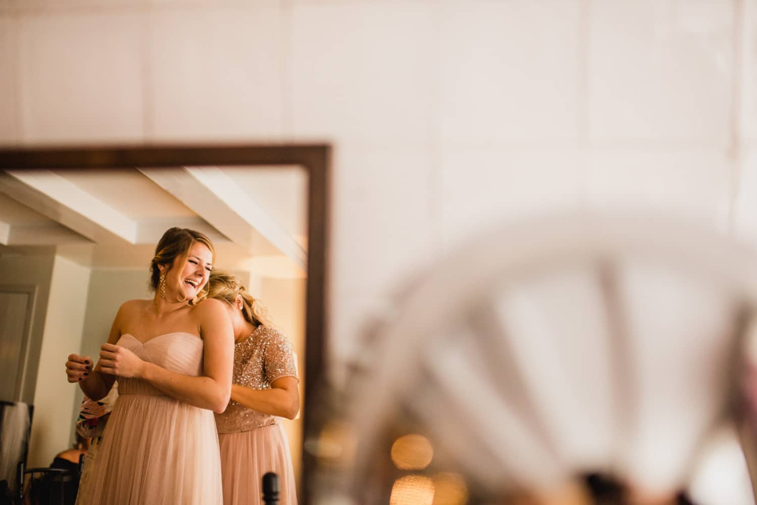 reflection of bridesmaid in mirror