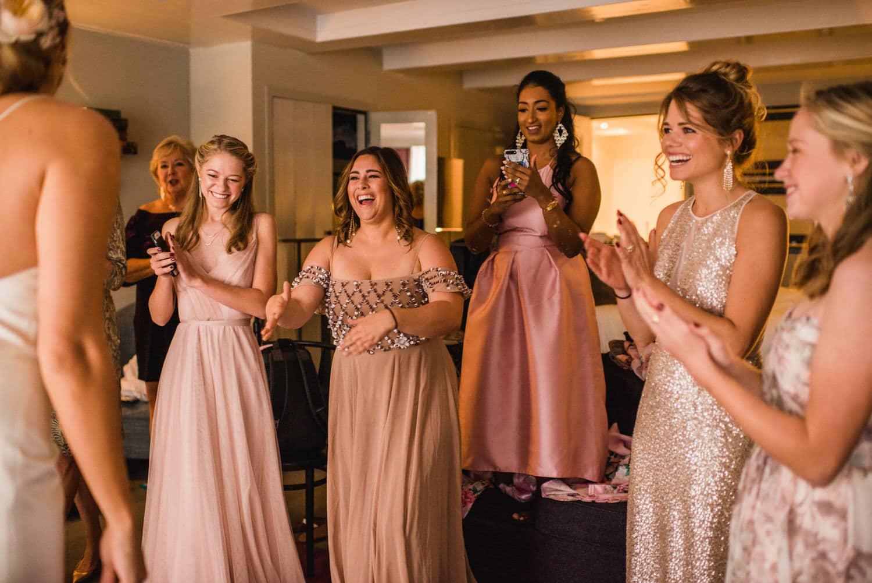 bridesmaids seeing bride in dress at Pulitzer Hotel Amsterdam
