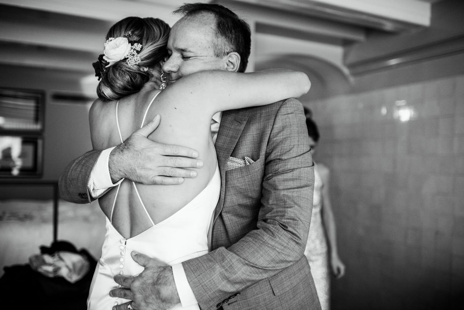 father hugging his daughter on wedding day