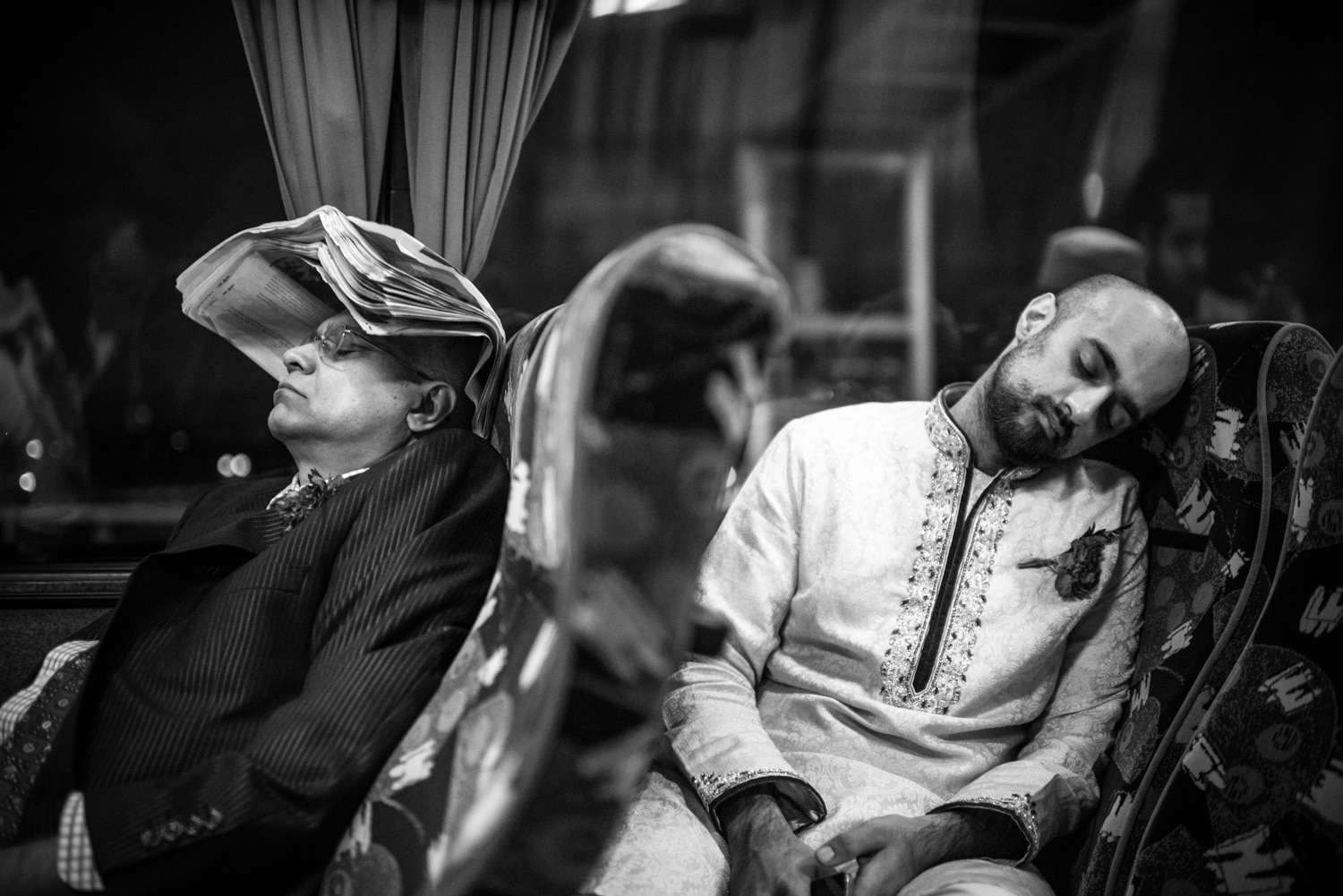 wedding guests sleeping on bus