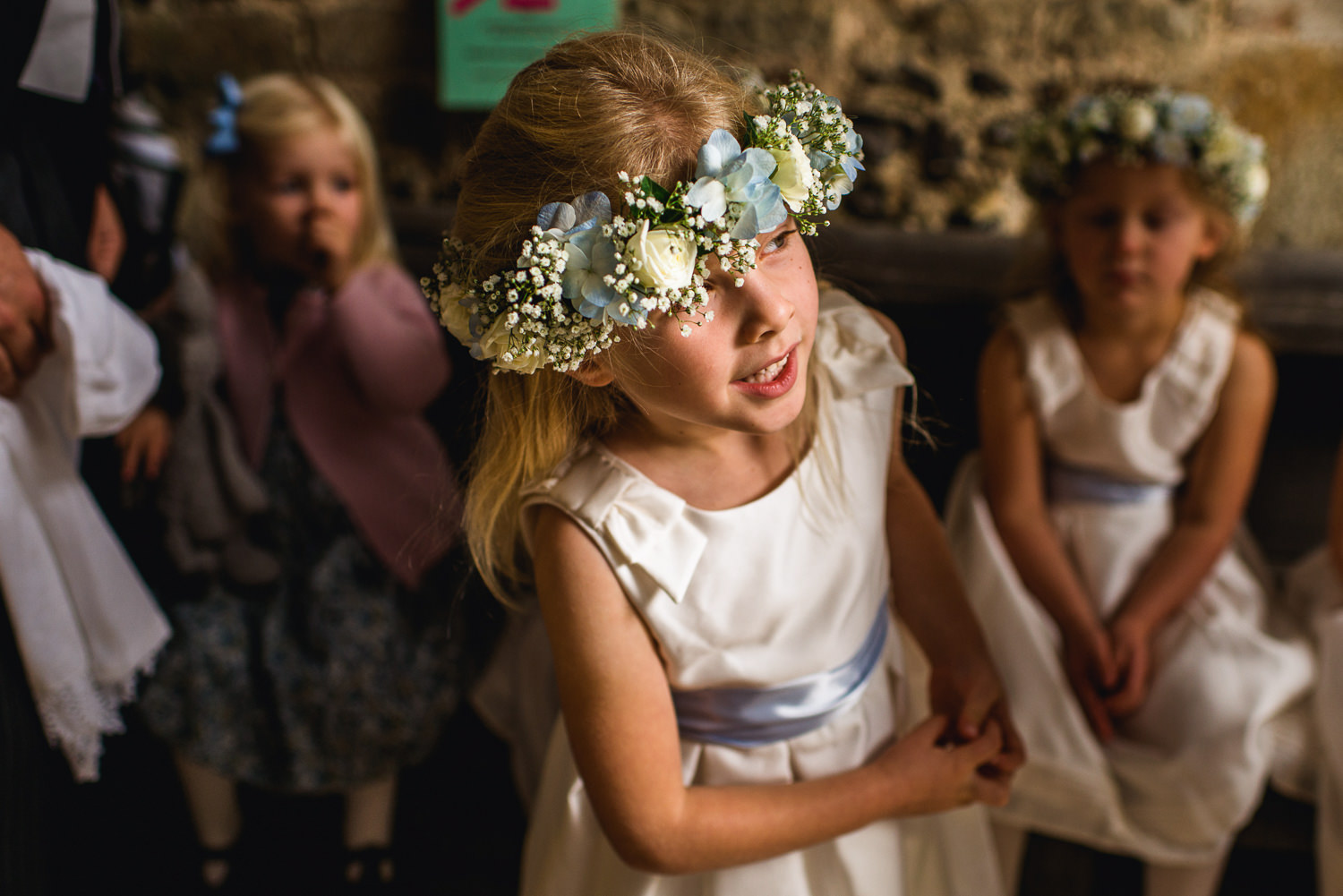 Flower girl at wedding with flower crown