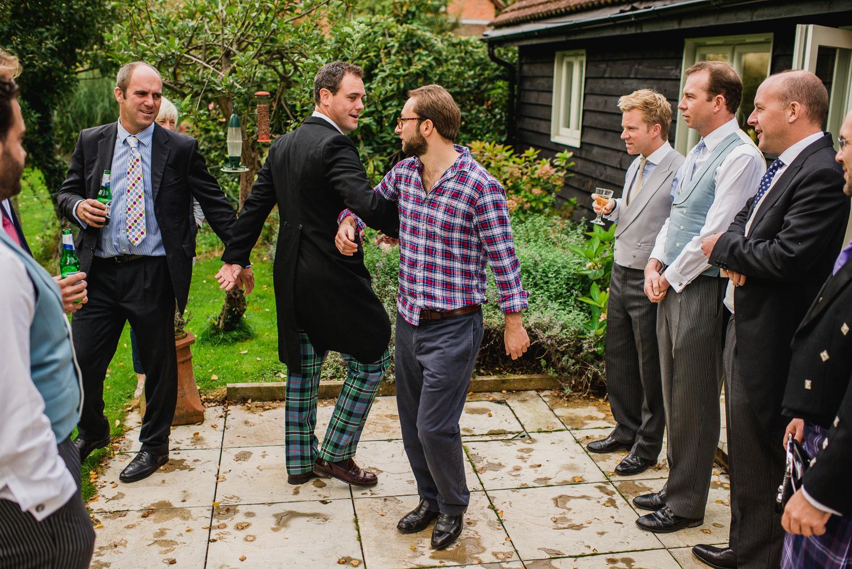 Groomsmen practicing their dancing