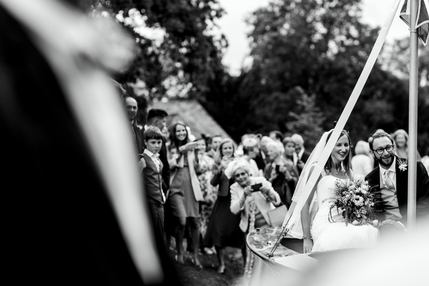Bride and groom leaving church on boat