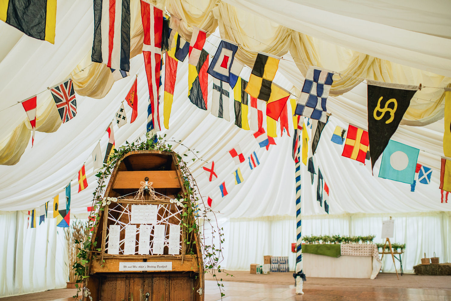 wedding marquee decorated with flags