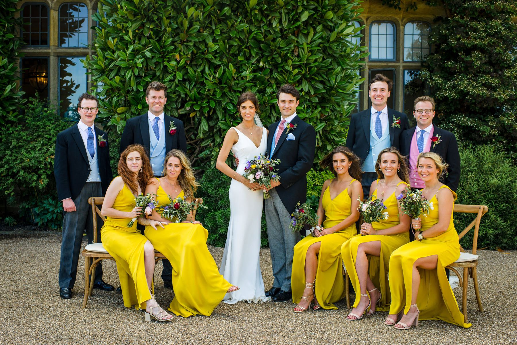 formal wedding photo, yellow bridesmaids dresses