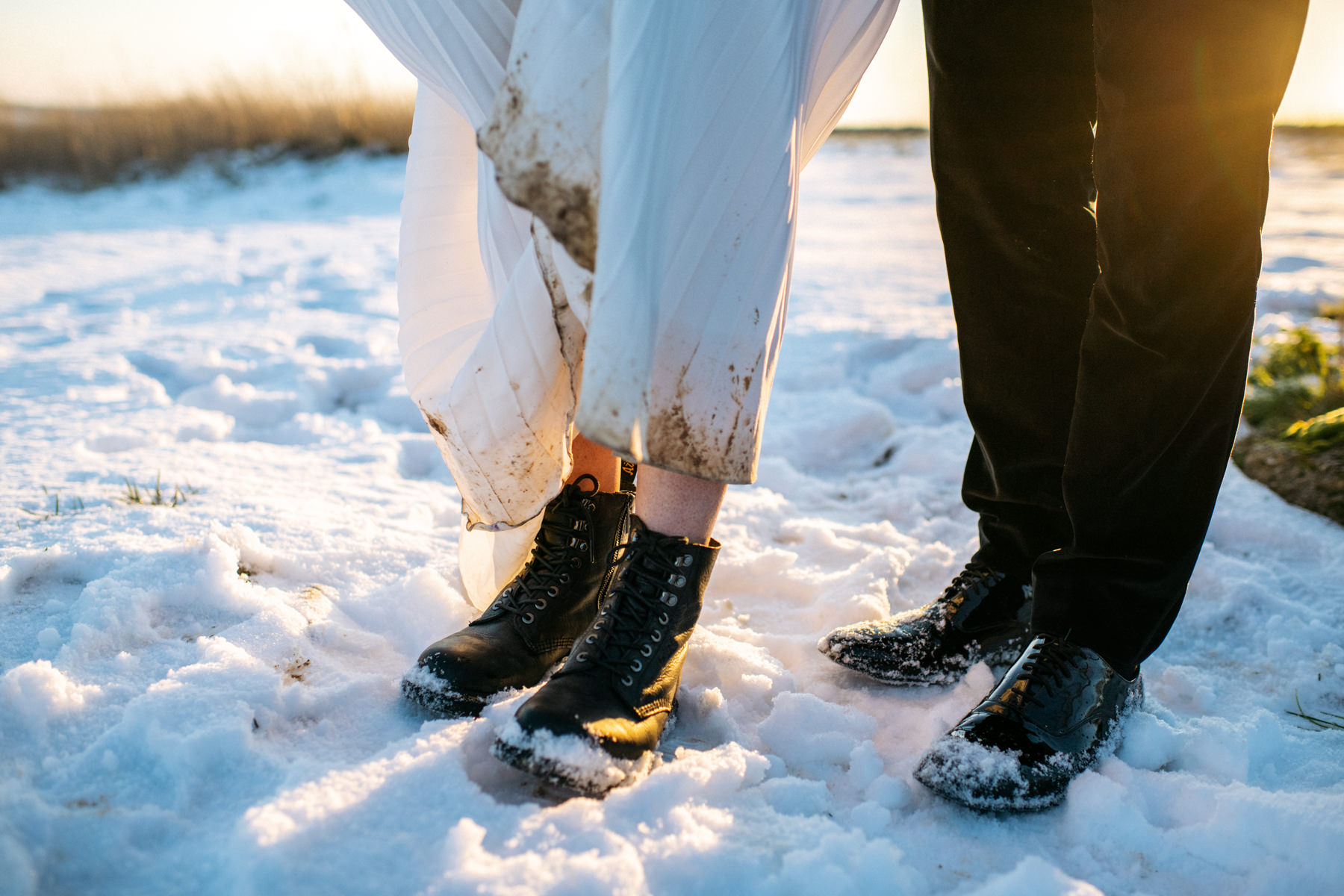 dirty wedding dress in snow